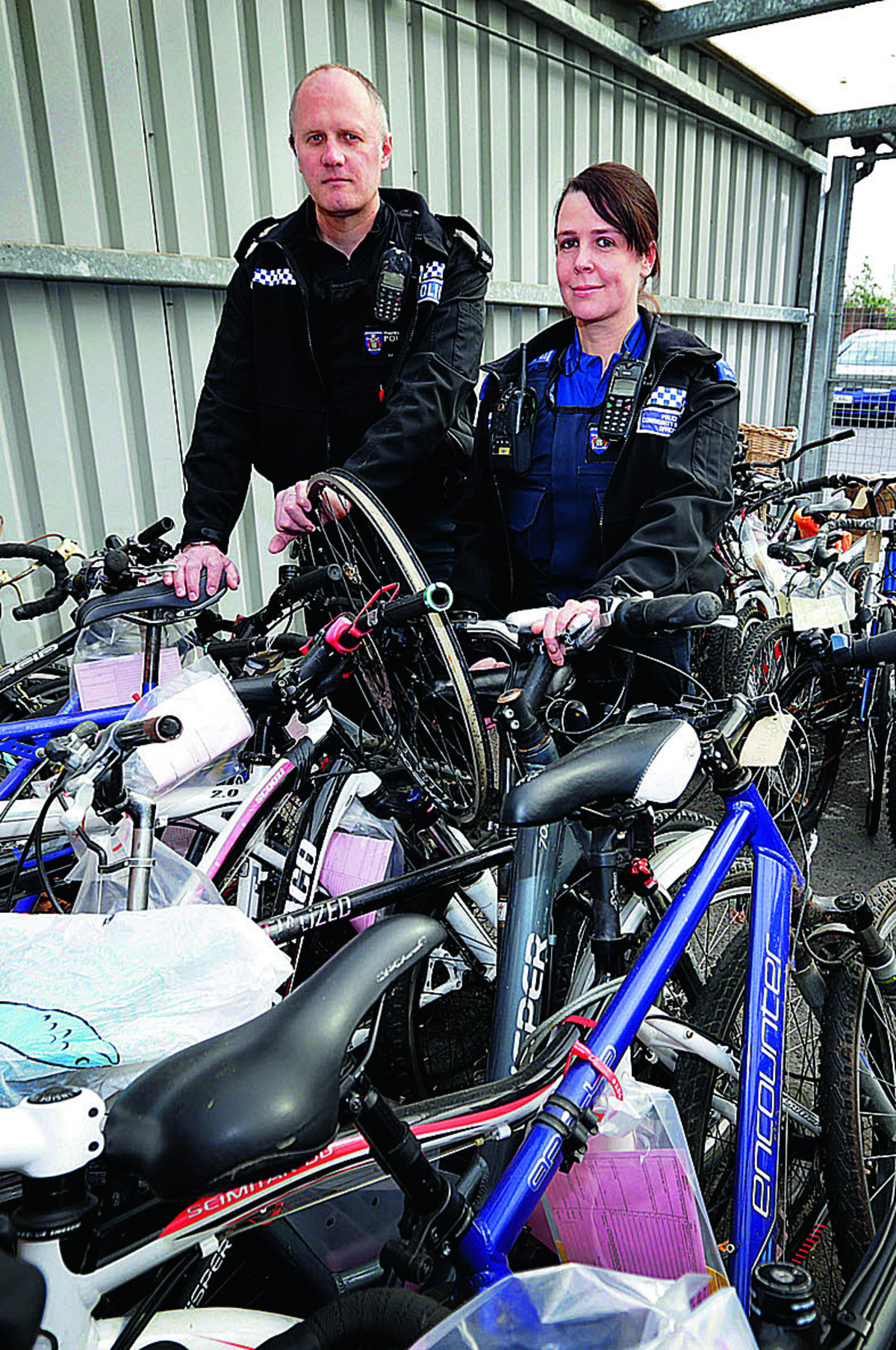 Pc Carl Bryant and PCSO Ali Blood with unclaimed bikes being held at Abingdon Police Station