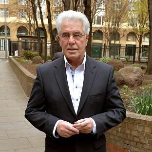 Publicist Max Clifford is giving evidence in his def