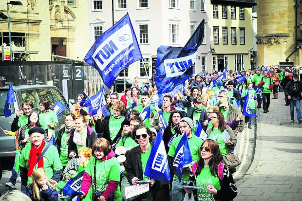 Striking teachers and supporters march along Broad Street, Oxford. Picture: OX66177 Damian Halliwell