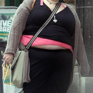 England's chief medical officer said too many people may be ignoring the growing problem of obesity