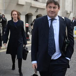 Herald Series: Charlie Brooks and his wife, former News International chief executive Rebekah Brooks, leave the Old Bailey in London