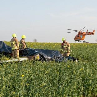 Herald Series: Emergency services at the scene of a plane crash in a field off the A414 near Ongar, Essex (PA/ Essex County Fire and Rescue Service)