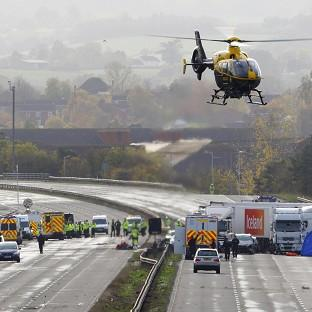 Emergency services work at the scene on the M5 motorway close to Taunto