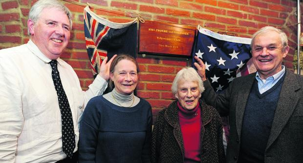 Juliet Noel and Joan Reade unveiling the plaque with Jon Wain, left, and Lt Col Harris Bartine USAF (Retd)