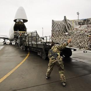 Equipment being loaded into a Boeing 747 headed for the UK after being recovered from closed down UK operating bases in Helmand Province
