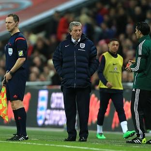 Roy Hodgson will not ban players from making their own arrangements for their families to travel to the World Cup
