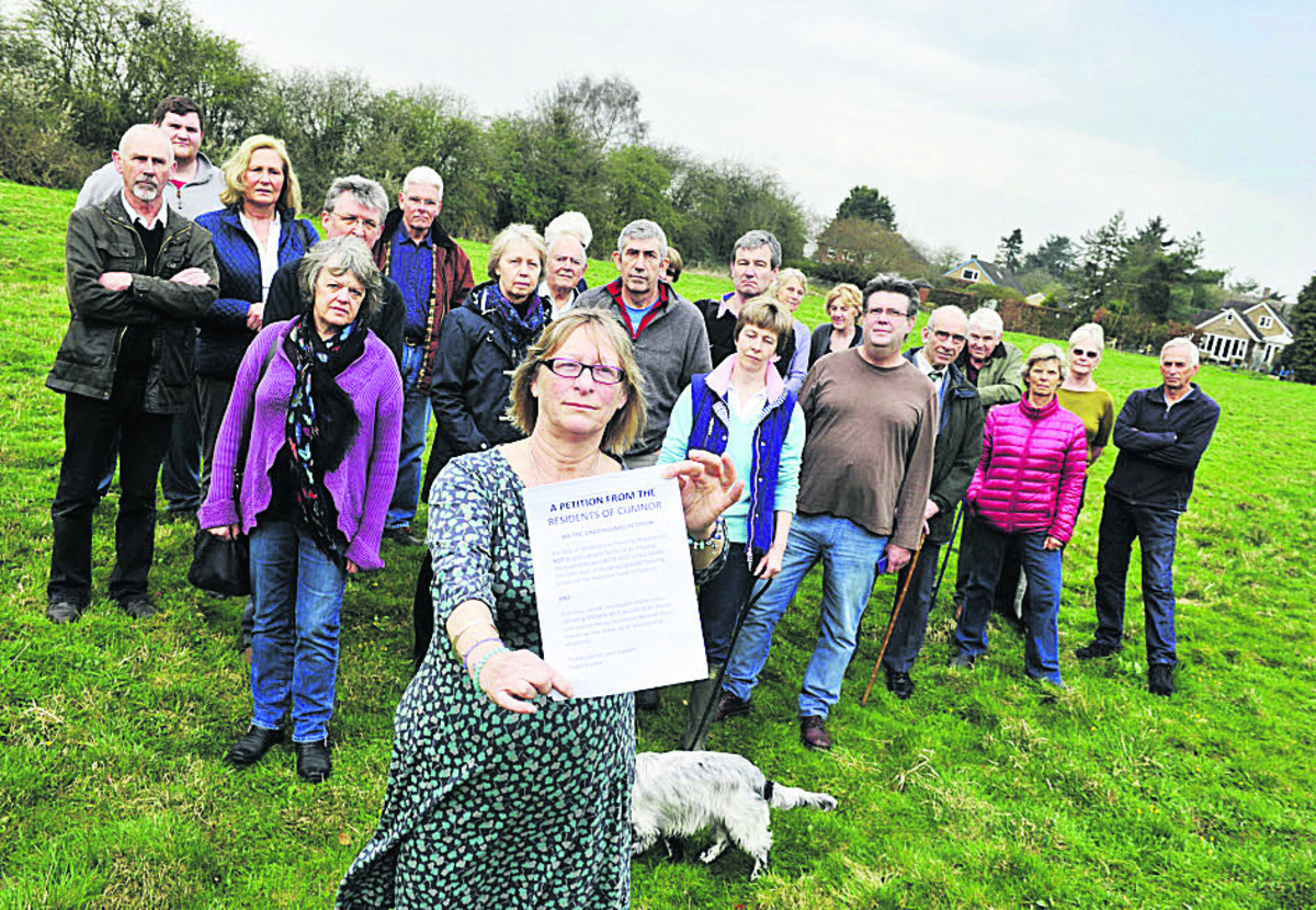 Judy Sissons and other villagers on the Green Belt land that could be earmarked for housing on the edge of Cumnor. Picture: OX66331 Mark Hemsworth