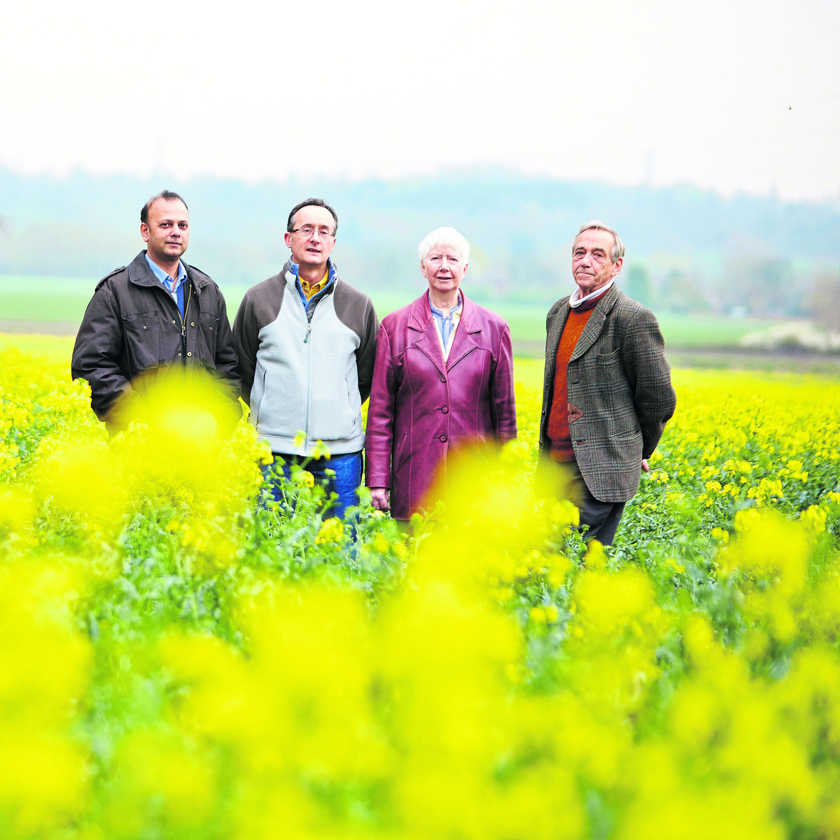 Campaigners pictured in one of the fields which could disappear. From left to right: Dhiraj Kallie, John Platts, Jenny Standen and John Standen