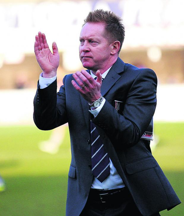 Herald Series: Gary Waddock applauds the United fans who made the trip to Dagenham & Redbridge last Saturday	 Picture: Dan Westwell