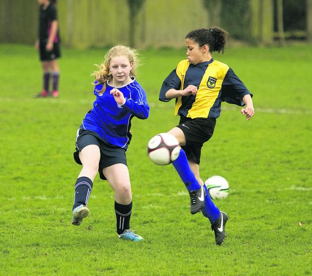St Gregory the Great pupil Elyse Thomas-Collaire, right, in action against Zosia Pears, of Cherwell School