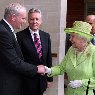 Martin McGuinness, left, will attend a state banquet at Windsor Castle hosted by the Queen, during an official visit by Irish President Michael D Higgins to the UK next week