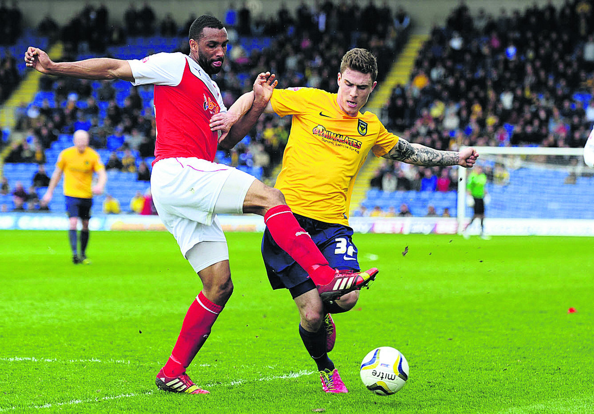 Oxford United's Josh Ruffels, seen being challenged by Fleetwood Town's Nathan Pond during last Saturday's 2-0 defeat, says Oxford have it all still to play for