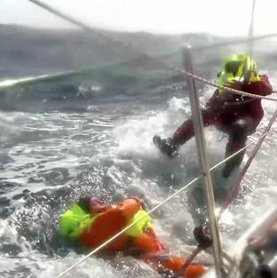 Herald Series: Andrew Taylor (left) being rescued by Jason Middleton after falling overboard during the Clipper Round the World Yacht Race (Clipper Ventures/PA)