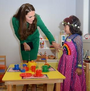 Herald Series: The Duchess of Cambridge meets Bailey Taylor, six, during her visit to the Rainbow Place Children's Hospice in Hamilton, New Zealand