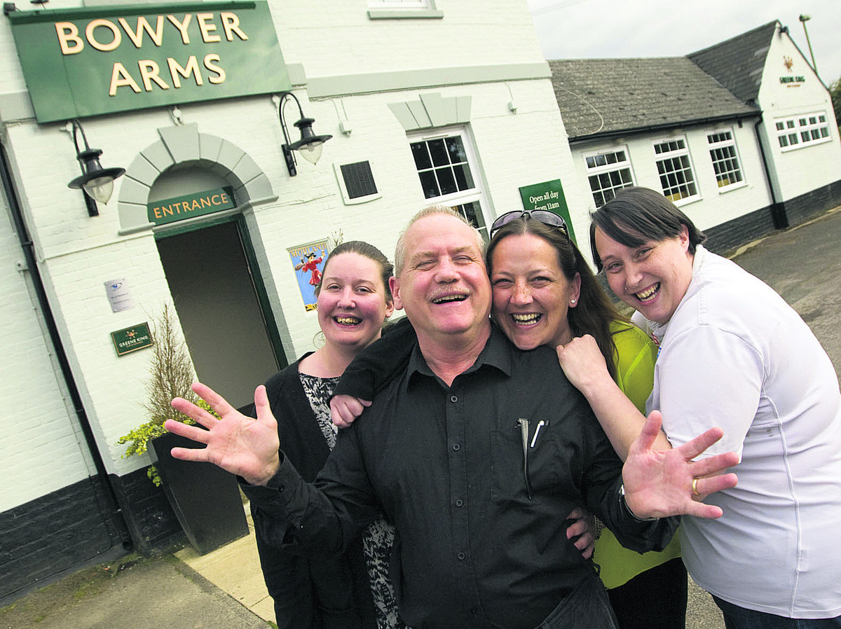 Paul Chance, landlord of the Bowyer Arms with, from left, Carina Coppock, Tracie Guntert and Jodie Steptoe. Below: The story in last Monday's Oxford Mail which prompted the support. Picture: Antony Moore OX66553