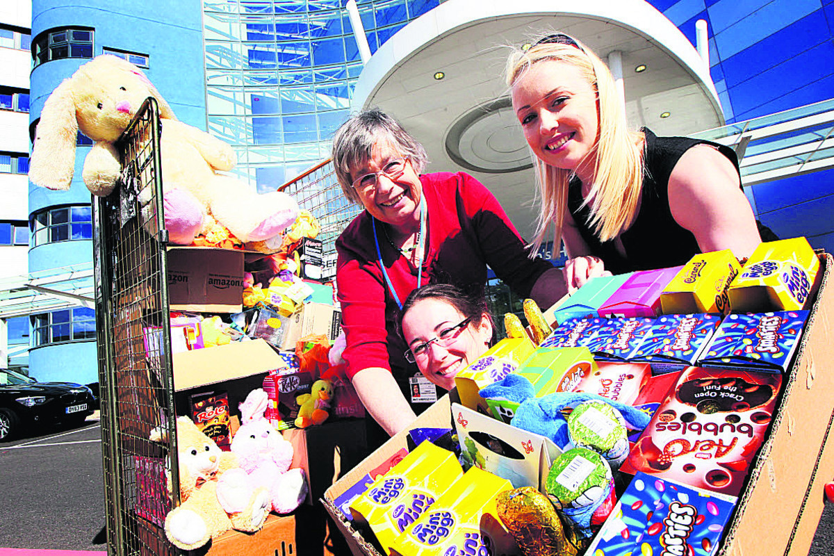 Penny Hambridge, left, of Oxford Children's Hospital, receives the Easter eggs from Alicia Medlicott and Alice Clarke, of recruitment firm Reed. Picture: OX66337 Ed Nix