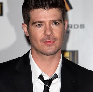 Herald Series: Robin Thicke's song Blurred Lines has been named the UK's most downloaded track of all time