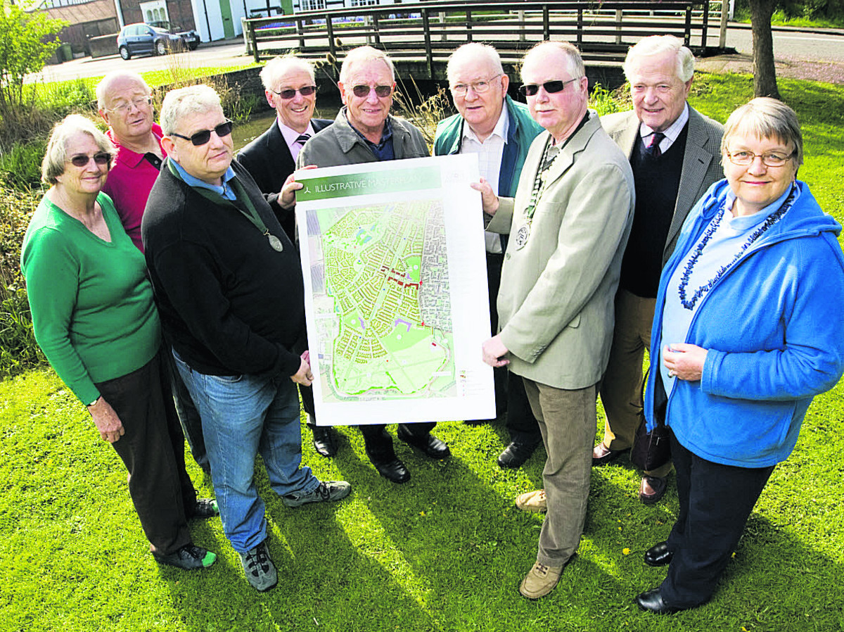Grove parish councillors Jean Nunn-Price, Stephen Dexter, vice-chariman Richard Ackers, Rodney Pollock, Bill Evans, Geoff Chown, chairman Frank Parnell, John Amys and Elisabeth Green holding the map Picture: OX66660 Antony Moore