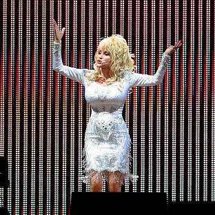 Dolly Parton is planning to wear high heels when she makes her Glastonbury