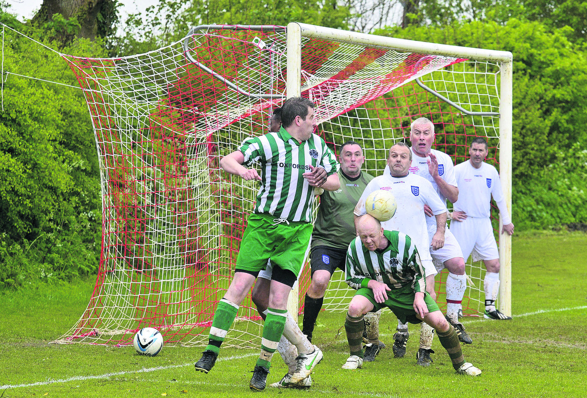 OCC's Chris Jones with a defensive header. Pictures: OX66725 Denis Kennedy