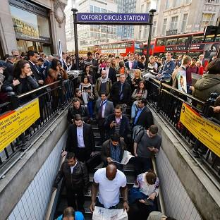 Herald Series: People queue outside Oxford Circus underground station, in central London, during the rush hour as the Tube strike continues