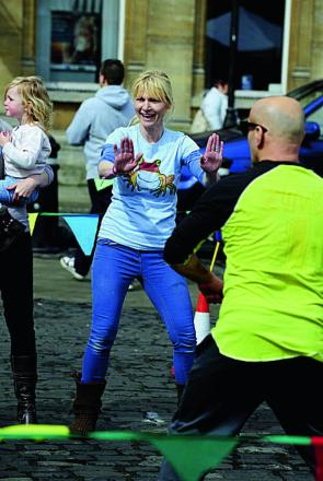 Vicky Lamb joins a zumba class at the event