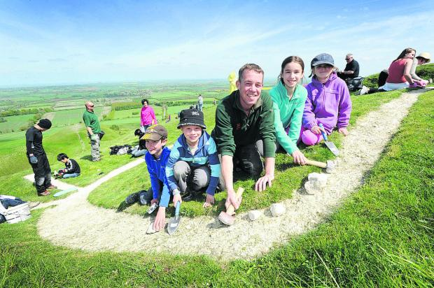 Herald Series: White sutff: National Trust ranger Andy Foley with, from left, Aidan Slark, nine, Thomas Robinson, eight, Abbie and Jodie Slark, 11 and seven respectively