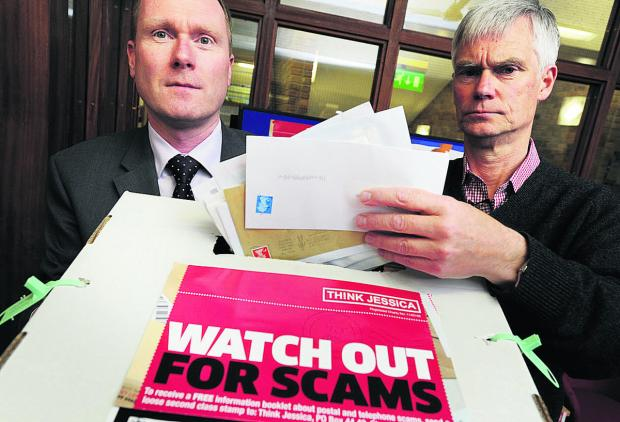 Herald Series: Richard Webb, head of Oxfordshire County Council's Trading Standards department, left, and David Soward, from Oxfordshire Consumer Empowerment Partnership