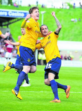 Scott Davies celebrates Ryan Williams's early goal for Oxford, before things went bad for the winger, w