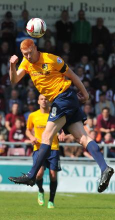 United striker Dave Kitson, pictured in action during Saturday's 3-1 defeat at Northampton Town, will have talks with manager Gary Waddock this week to determine his future at the club