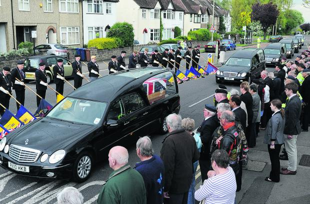Herald Series: HONOUR: Members of the public and British Legion stalwarts stand in silence at Headley Way, Oxford, as the cortege arrives at the John Radcliffe Hospital