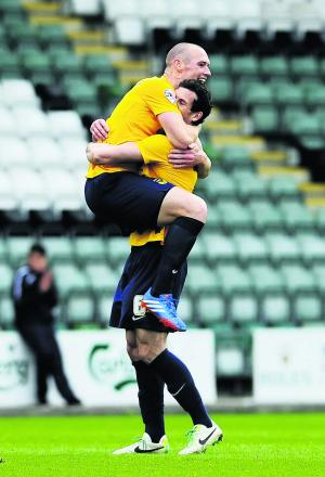 Jake Wright (right) hugs James Constable after the striker scored at Plymouth last season. The duo could both stay at Oxford next season