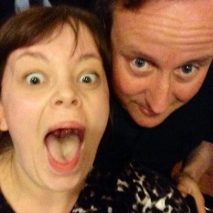 Prime Minister David Cameron poses for a selfie with Becky Smith in Nandos, Park Street, Bristol, during a visit to the city. (Becky Smith/PA)