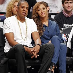 Jay-Z and his wife Beyonce, watching a basketball game in New York, hours after the video leak (AP)