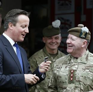 Herald Series: Prime Minister David Cameron met with members of the Armed Forces during his visit to Glasgow on Thursday