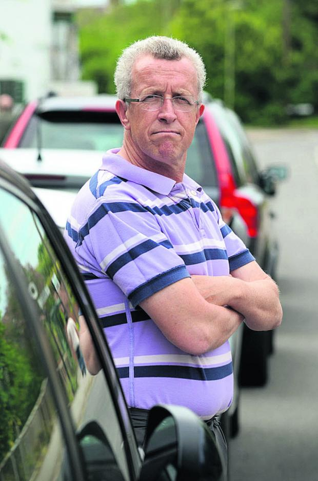 Herald Series: Graham Steinsberg, along with other with villagers in Radley, is upset about parking at and near the railway station 	Picture: OX67320 Marc West