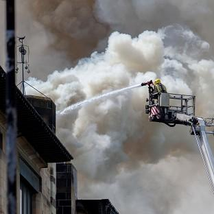 Herald Series: Firefighters tackle the blaze at Glasgow School of Art's Charles Rennie Mackintosh building (PA/David Barz)