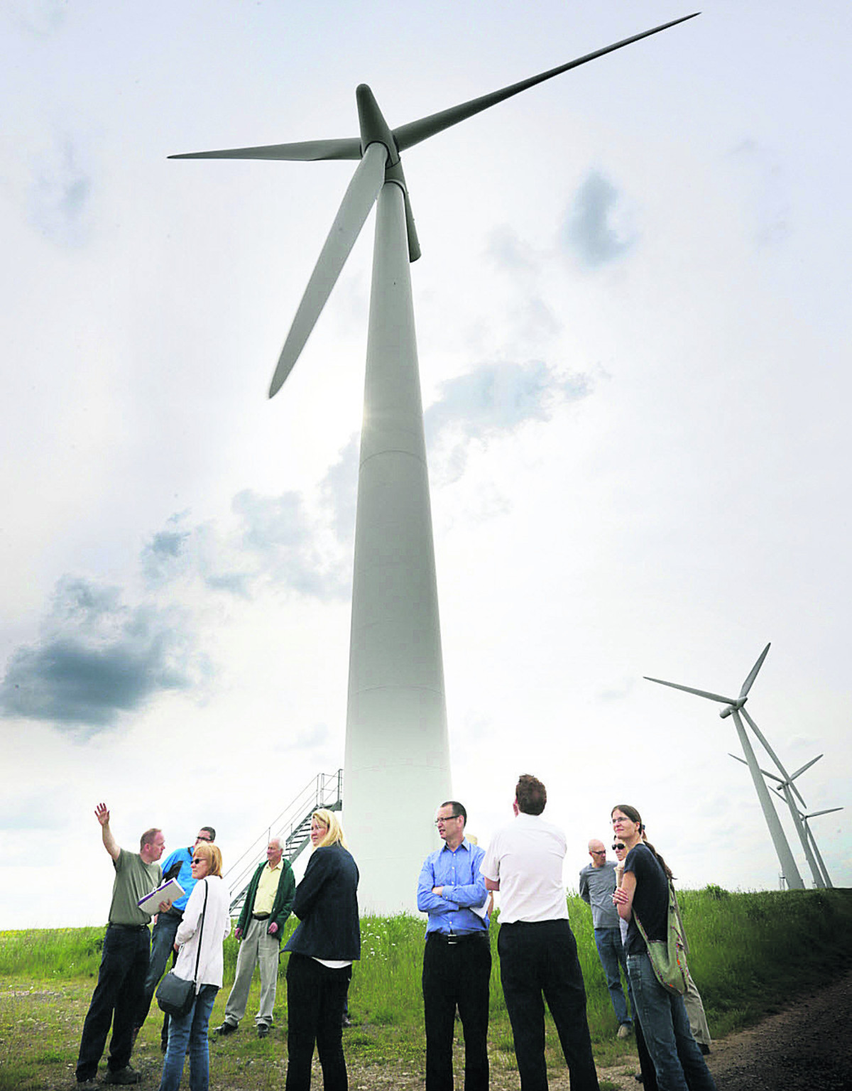 Westmill Sustainable Energy Trust volunteer guide, David Abley, left,  takes visitors on tour of the wind turbines and photovoltaic panels at Westmill Wind Farm and  solar park. Picture: OX67332 Damian Halliwell