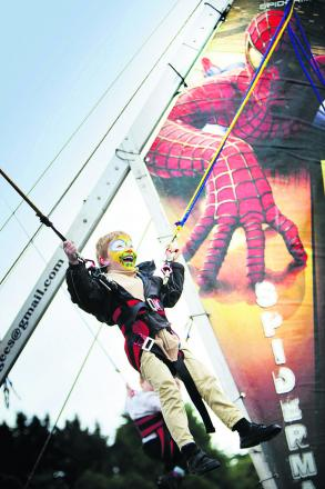 Tommy Vereker, six, is lifted aloft on the Spiderman bungee at Harwell Feast