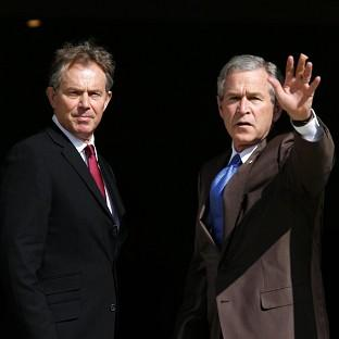 Former Prime Minister Tony Blair, pictured with George Bush, has ducked calls t