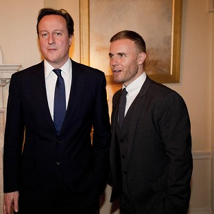 There is speculation Prime Minister David Cameron may not invite singer Gary Barlow to a 10 Downing Street event after a tax controversy