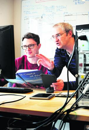 Apprentice Nick Bracey, left, with Andy Severn, who runs Oxford e-Books