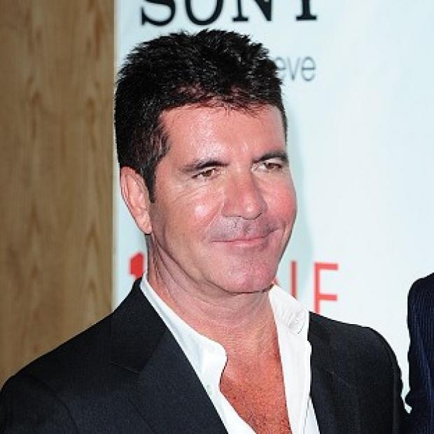 Herald Series: Simon Cowell said he will support son Eric if he wants to be a singer, but will be honest about his abilities