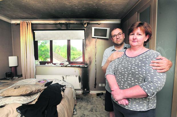 Elaine and Quentin Bossom in the bedroom set on fire by lightning on Saturday