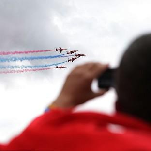 Herald Series: The Red Arrows display team flying above the Isle of Wight Festival