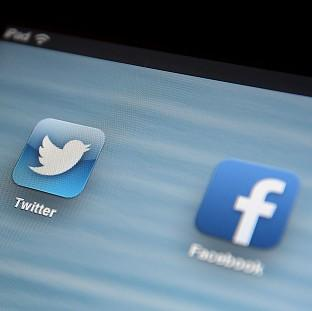 Herald Series: A legal loophole means Facebook status updates and Twitter posts are being monitored by the UK Government
