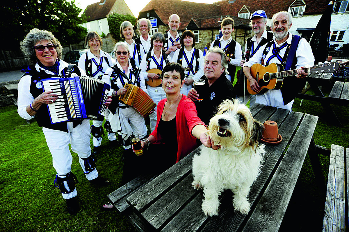 Phil and Karen Middleton with their dog Tinker and, second from left, Charlotte Ritchie and Cry Havoc Morris dancers        	 Picture: OX67632 David Fleming