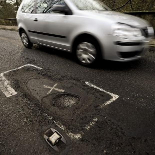 Herald Series: A multi-million pound fund is being set up to tackle potholes