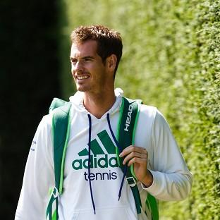 Andy Murray arrives for the start of a practice session ahead of Wimbledon
