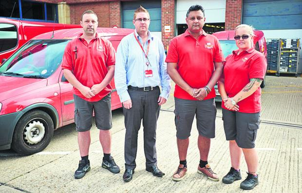 Herald Series: From left, postman Derek Clerkin, delivery office manager Scott Lovell, Steven Gill and postwoman Sam Prescott at Royal Mail's Oxpens office. Picture:OX68165 Cliff Hide
